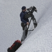 Cameraman ready to film drama action sequence on Mont Blanc.